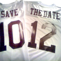 white jerseys with navy blue lettering and save the date printed