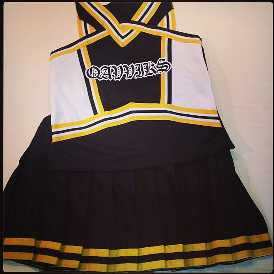 old english with outlines on cheer shell