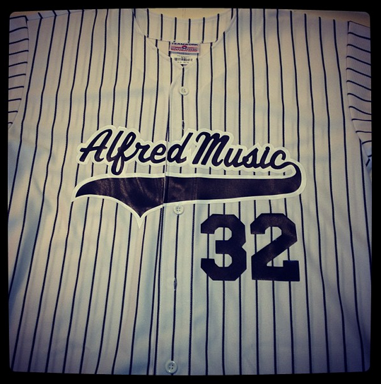Alfred Music with outlines on pinstriped jersey