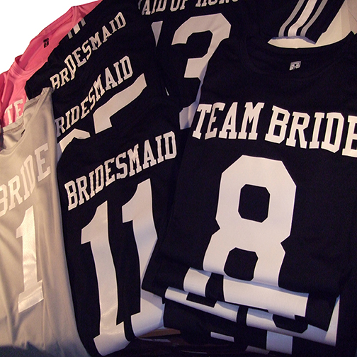 football jerseys in black and pink for bachelorette party or football wedding