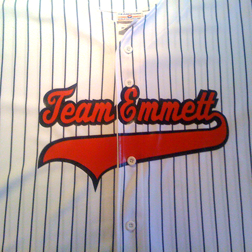 custom two color team name with tail in orange and black on black pinstriped 1751p jersey
