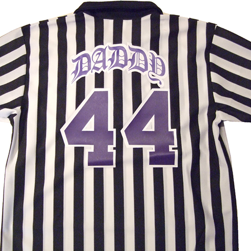 purple old english lettering on referee jersey